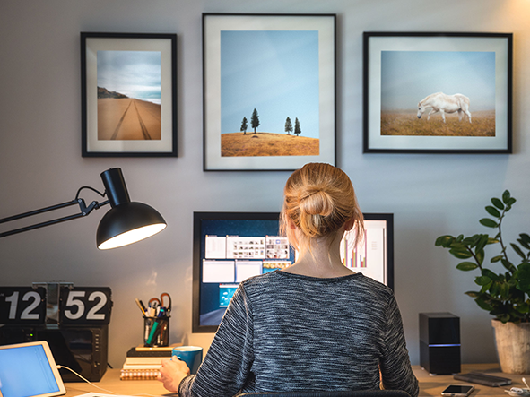 Hanging some art above your workspace gives you a chance to get creative