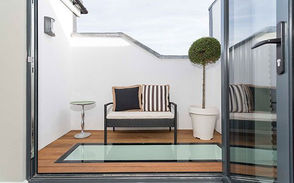 Loft conversion with roof terrace accessed from French windows