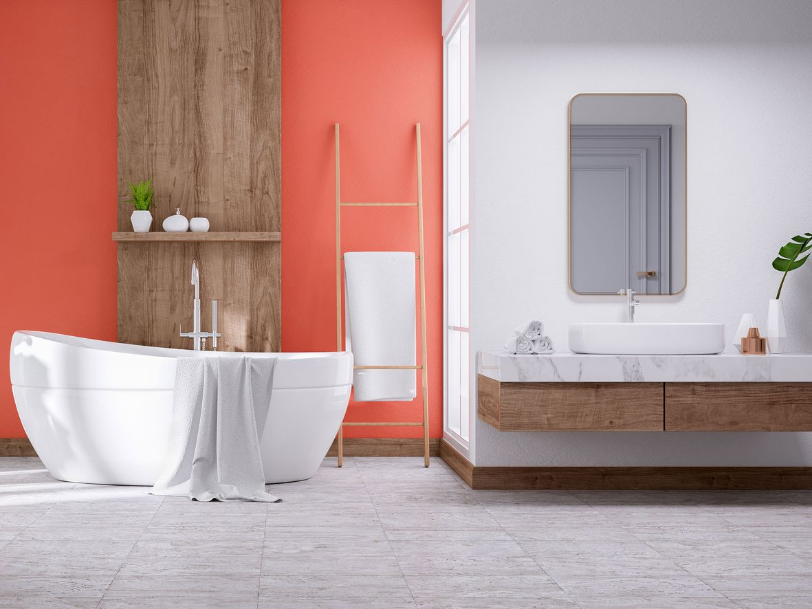 Bathroom with orange feature wall and oval bath, floating wood vanity unit and shelf ladder