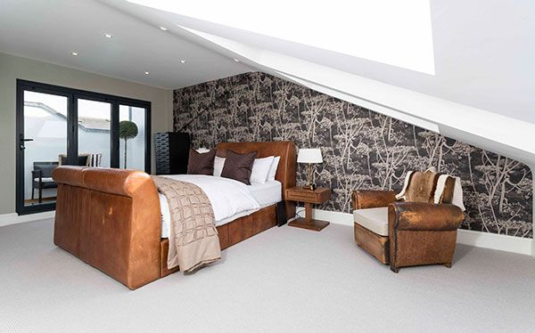 Large bedroom in dormer loft conversion with French windows