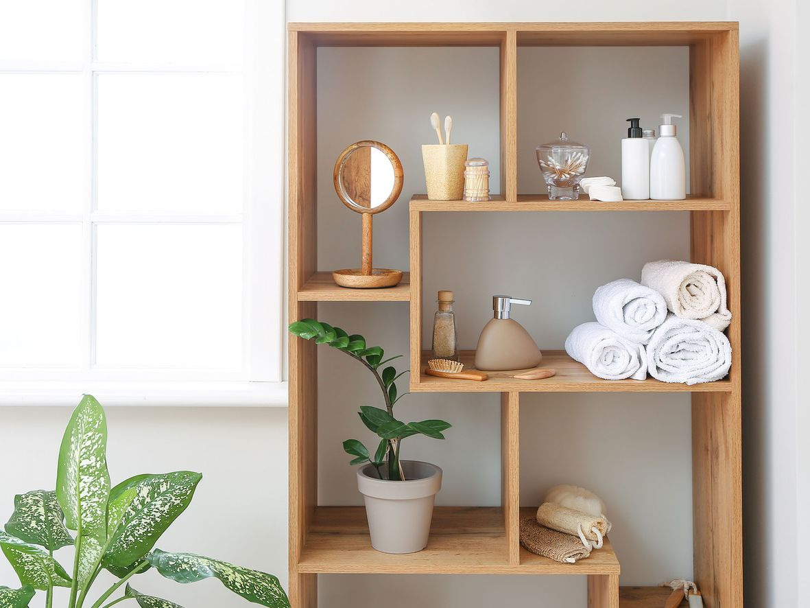 Wooden bathroom shelving unit with cube shelves at different angles