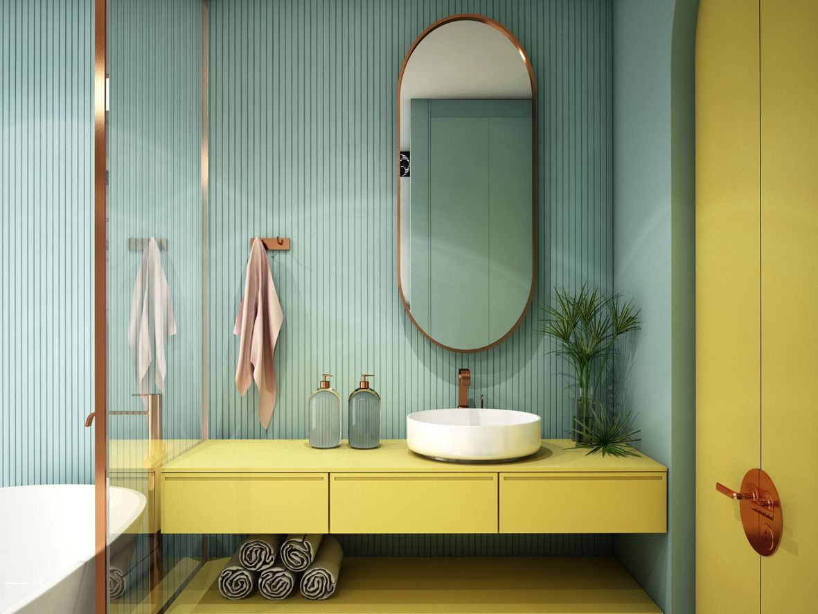 Green bathroom with rich yellow floating vanity unit and full-height cupboard