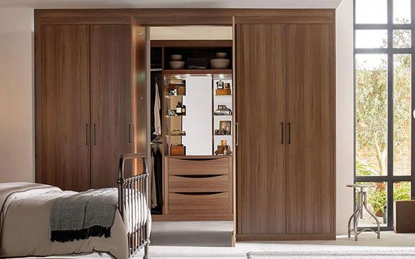 Sliderobes his and hers walk in wardrobe with opaque sliding doors