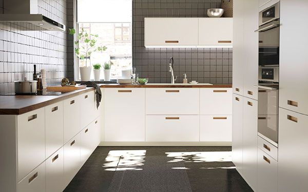 Modern Ikea kitchen with splashback tiles
