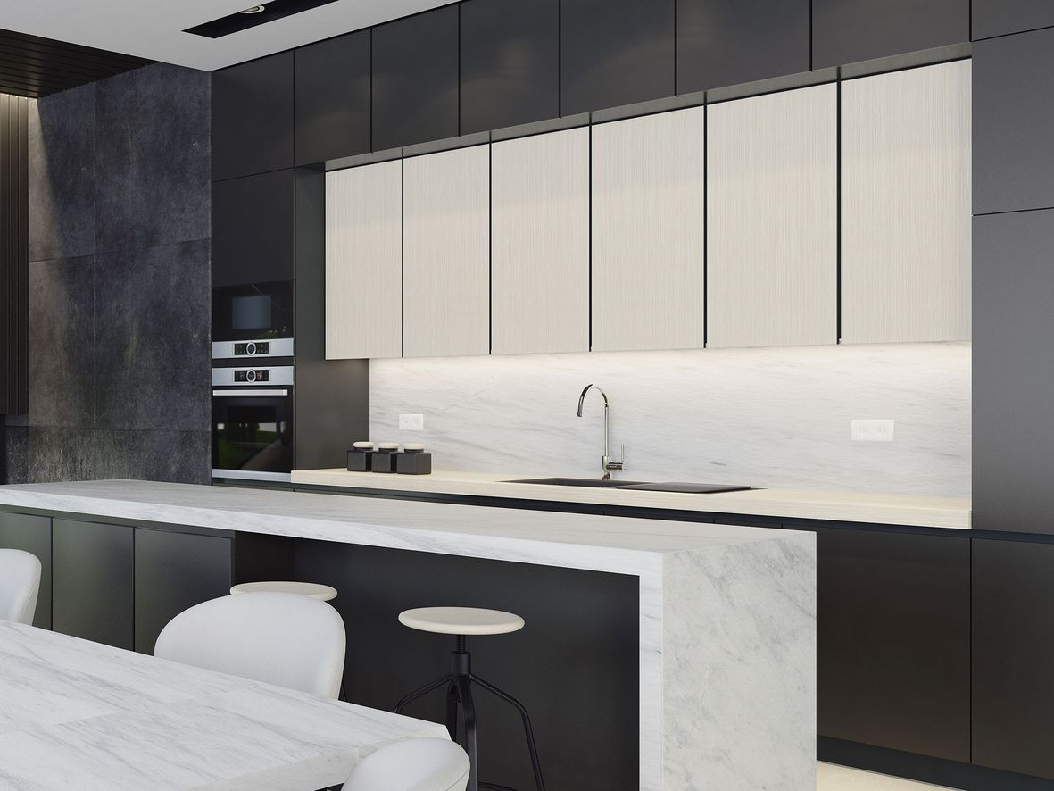 Black and white kitchen with a slimline kitchen island with seating