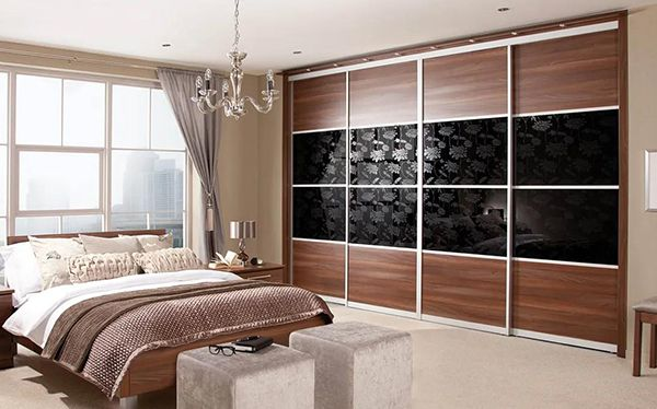 Sharps sliding wardrobe in walnut and black glass