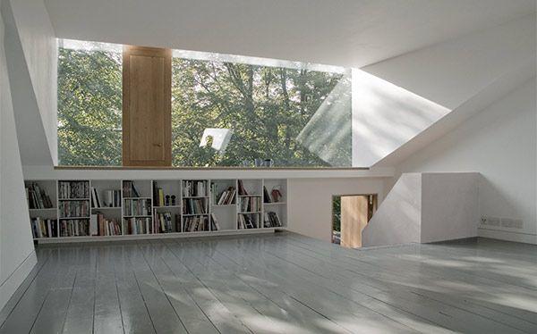 Modern white loft conversion with fully glazed dormer - interior