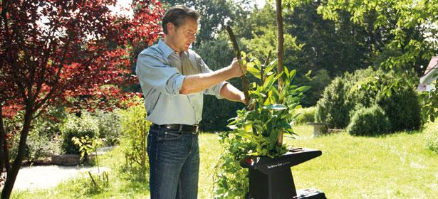 Man using garden shredder