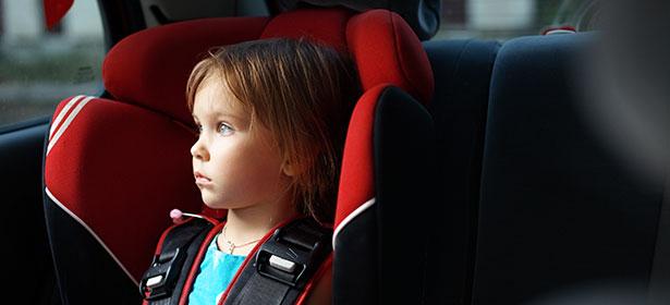 girl in child car seat