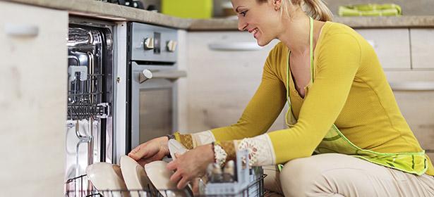 Woman loading dishwasher
