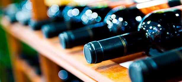 wine bottles on a wine rack