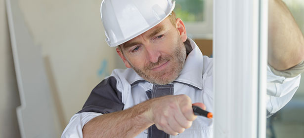 Man installing seal around double glazed window