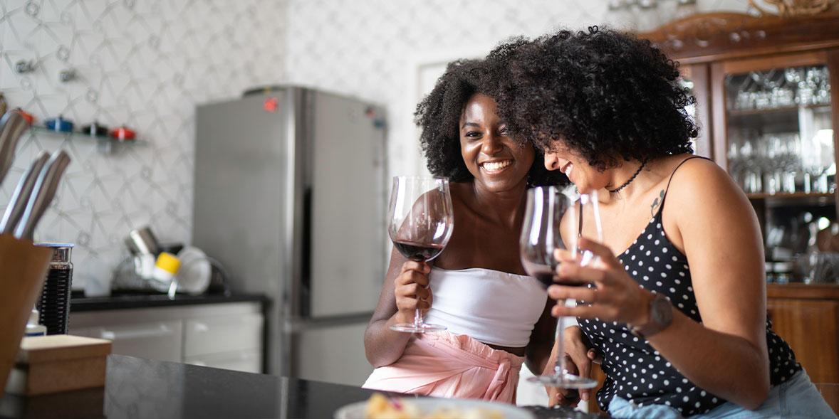 Two friends enjoying wine.