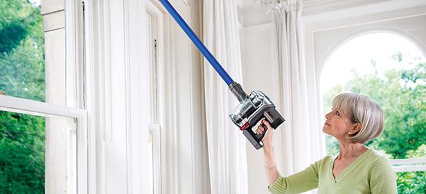 Lady using cordless vacuum_secondary