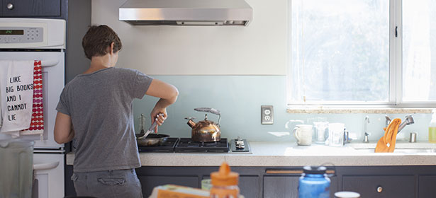 USED Person cooking on gas hob