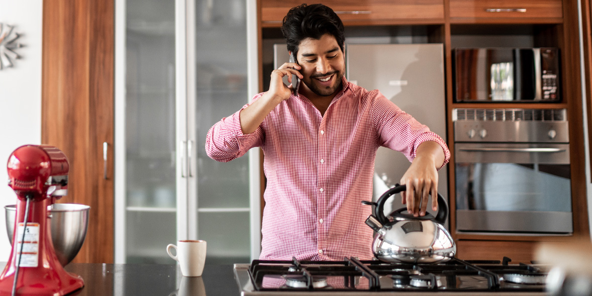 Man boiling a kettle on a gas hob