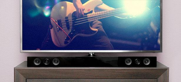 Sound bar on a cabinet underneath a TV