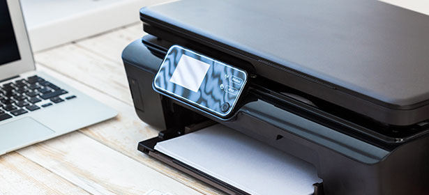Printer next to laptop