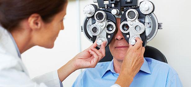 Man having an eye test at optician 448873