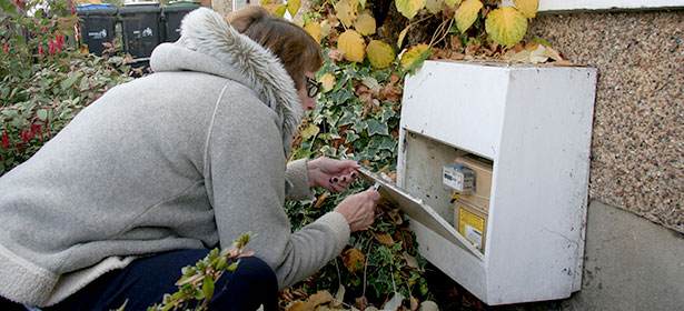 Woman reading a gas meter