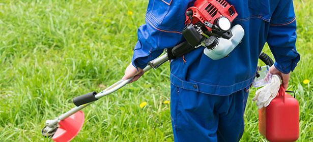 using a petrol grass trimmer