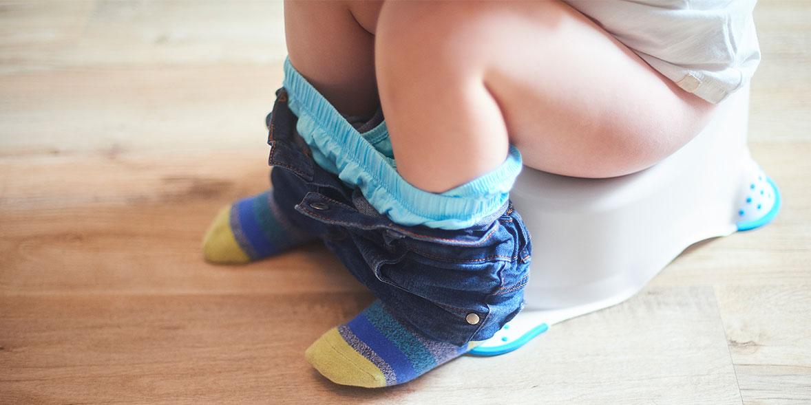 Child sitting on potty