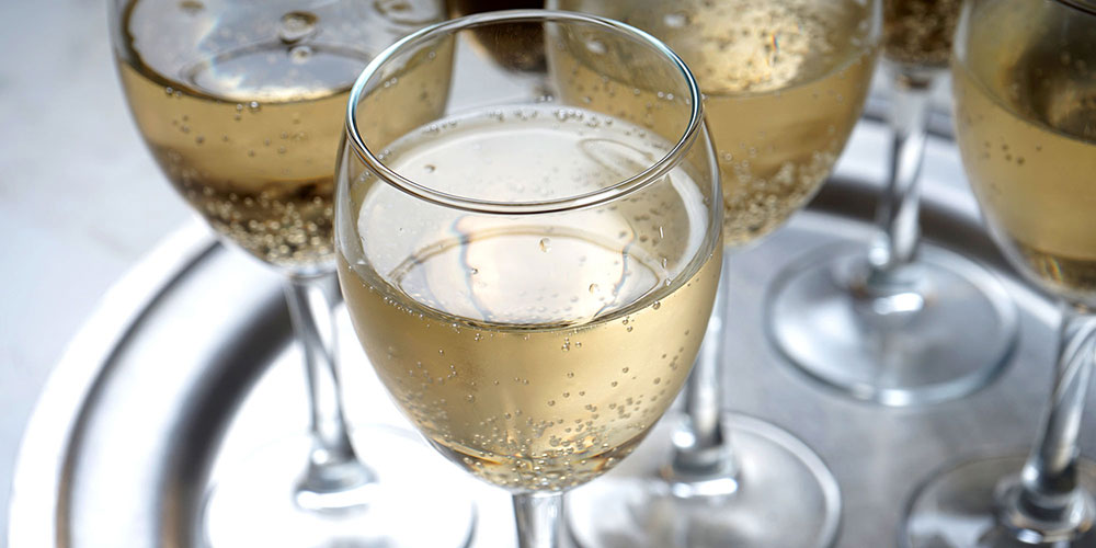Glasses of sparkling wine on a silver tray