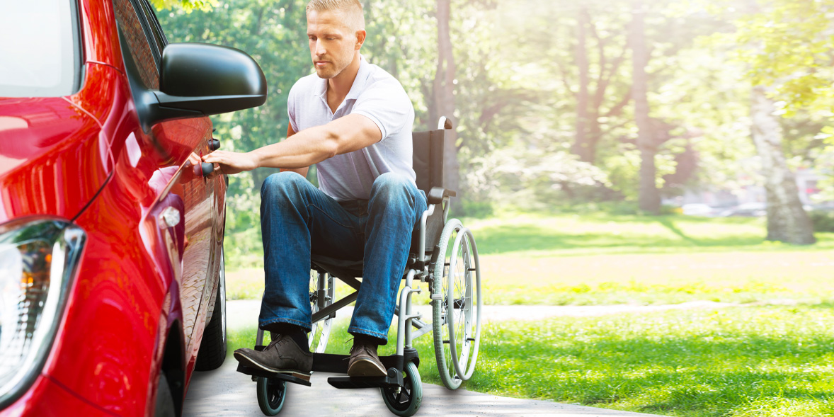 Man in wheelchair and car