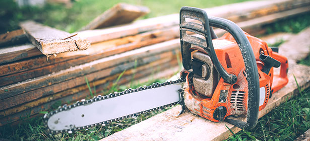 Petrol chainsaw rested on planks