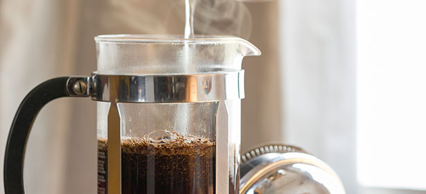 A cafetiere brewing coffee
