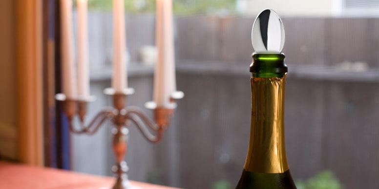 Teaspoon in champagne bottle