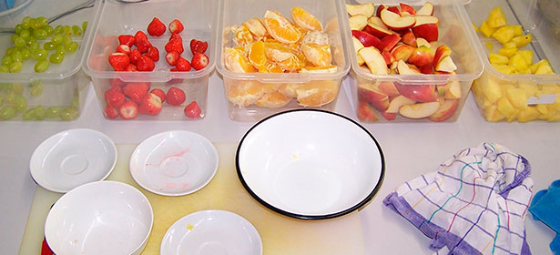 Bowls of chopped up fruit in lab before juicing