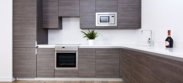 Kitchen with integrated fridge freezer