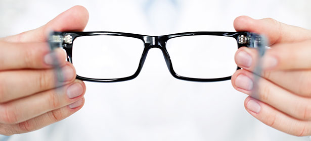Person holding out pair of glasses 439917