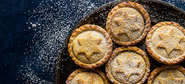 Star topped mince pies dusted with icing sugar