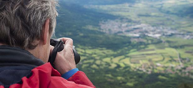 Man taking a photo of the horizon