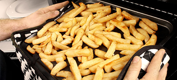 cooking oven chips on a baking tray