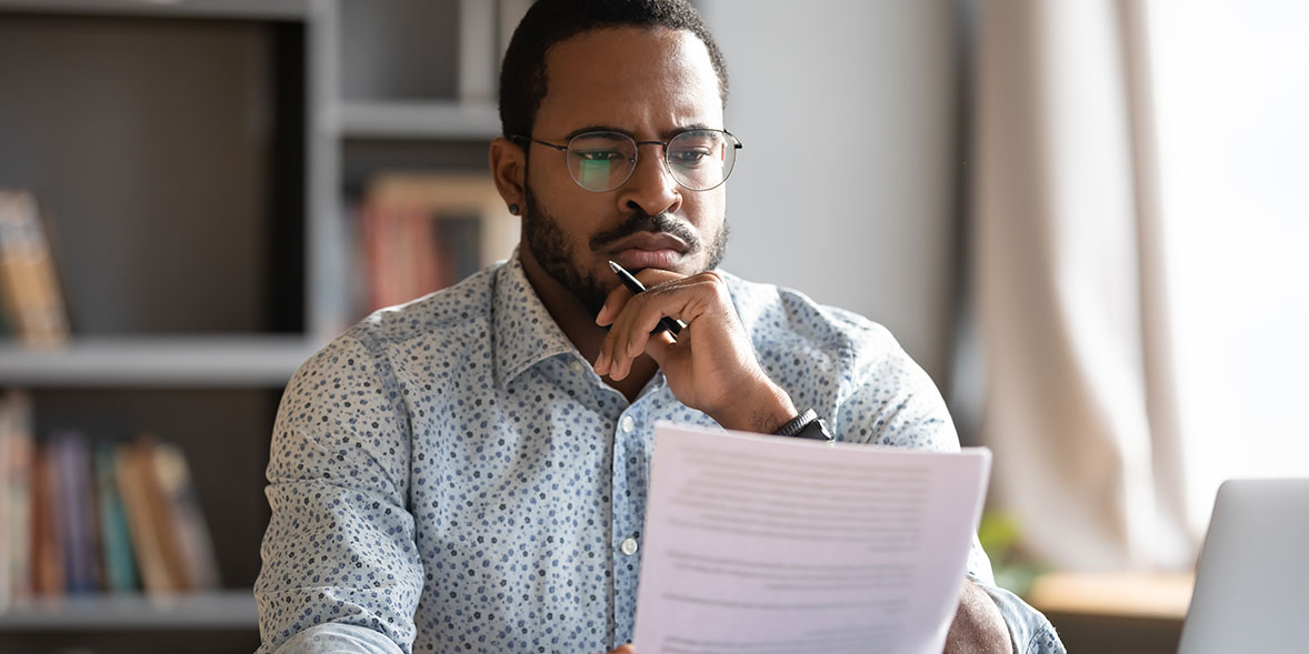 Man reading an energy bill and frowning