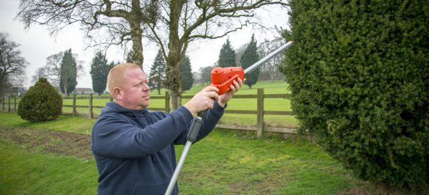 Man using a hedge trimmer