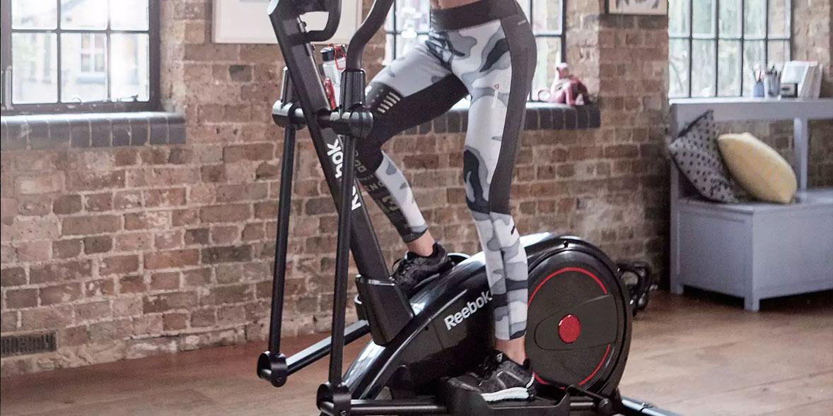 Legs on a Reebok exercise bike