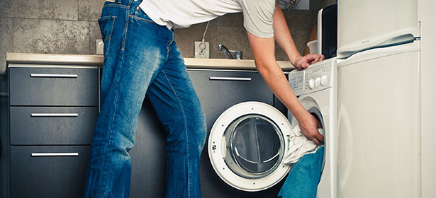 Man using a washer-dryer