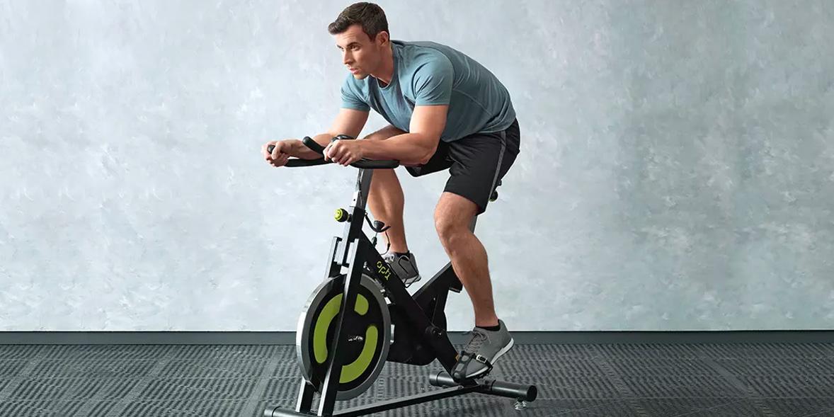 Man on an Argos exercise bike