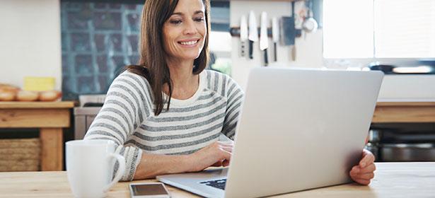 Woman using mac laptop