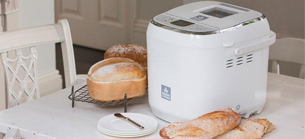 Bread next to bread maker in kitchen
