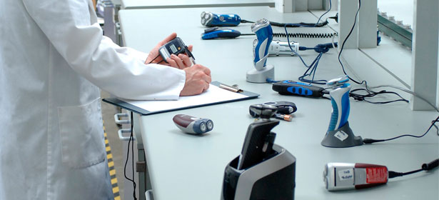 An image of electric shavers being tested in a lab
