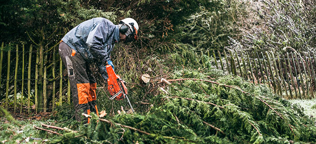 Man using a chainsaw