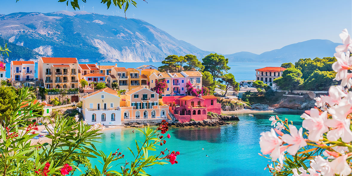 Pastel houses by the sea in Kefalonia, Greece