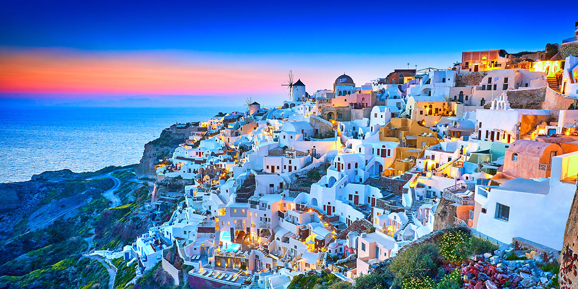 whitewashed houses on mountainside in Greece