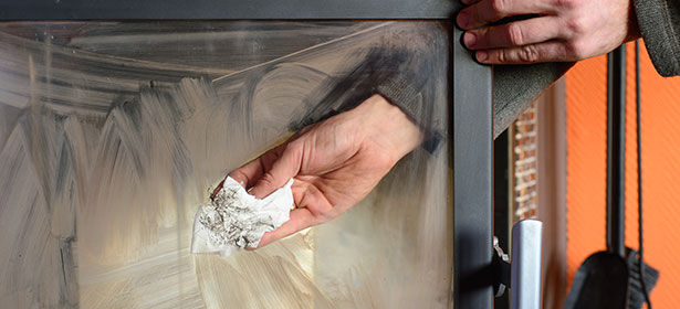 cleaning the glass front of a wood burner