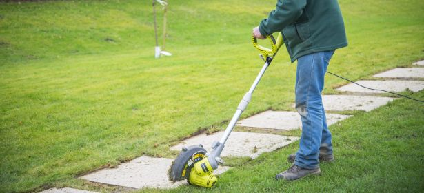 Electric grass trimmer edges a path